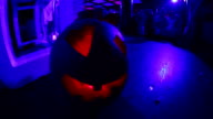 Skull of pumpkin in a nightclub. video