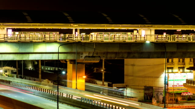 Sky Train Station and Traffic on Flyover Bridge, Night Time Lapse Video. video