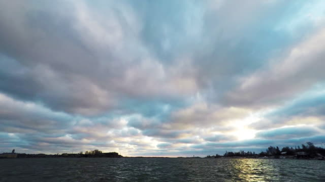 sky with сumulus clouds over the sea video