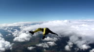Skydiver jumping from airplane and falling head down video