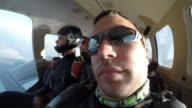POV Skydiver looking out the plane video
