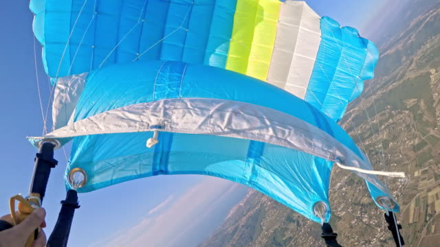 POV Skydiver overlooking the countryside below video