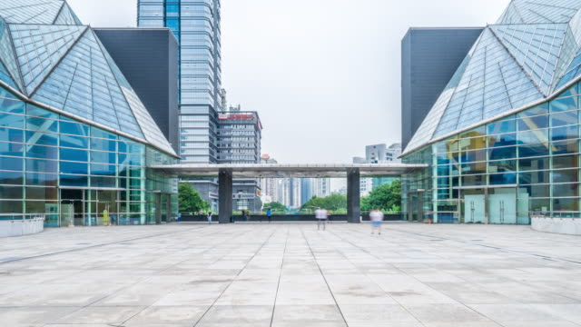 skyline and people on square in front of modern architecture far to near  timelapse hyperlapse 4k video