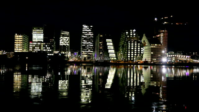 Skyline of Oslo at night reflecting in water. video