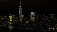 AERIAL: Skyline of World Trade and Financial Center complex lighted at night video