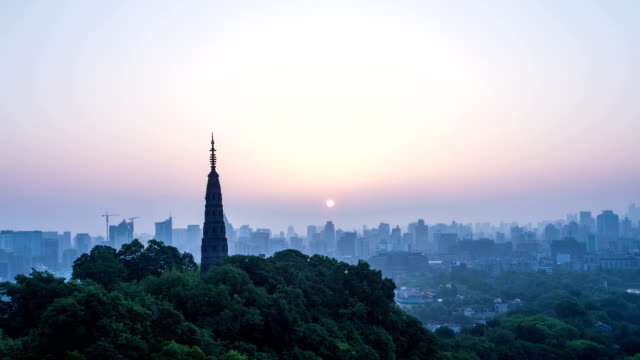 skyline,cityscape and pagoda of hangzhou during sunrise.Time lapse. video