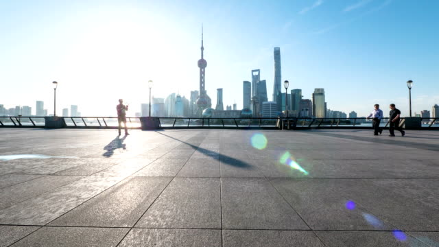 Skyline,commuter and modern buildings of shanghai during sunset.time lapse. video