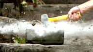 Sledge hammer smashing a concrete block video