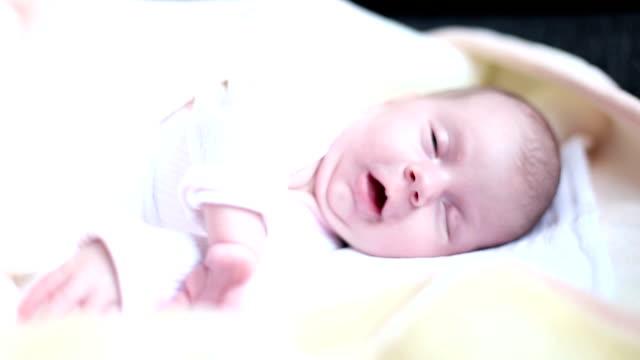 Sleeping baby yawning video