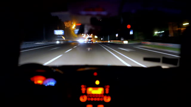 Sleepy tired driver behind the wheel, driving at night, risk of accident, DUI video