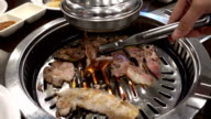 Slice beef grill on hot coals korea food style video