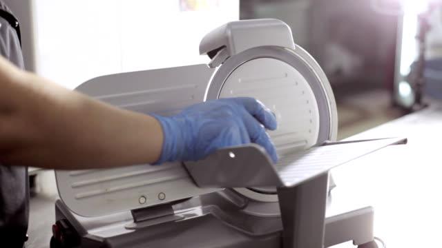 Slice machine cuts ham in commercial kitchen video