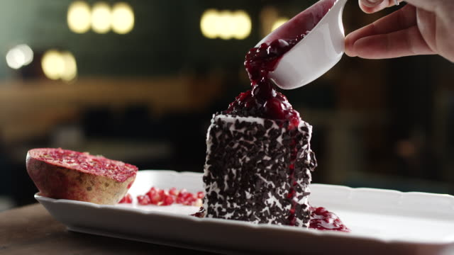 Slice of black forest cake with cherry toping video