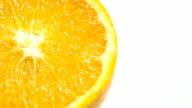 Slice of fresh orange isolated. video