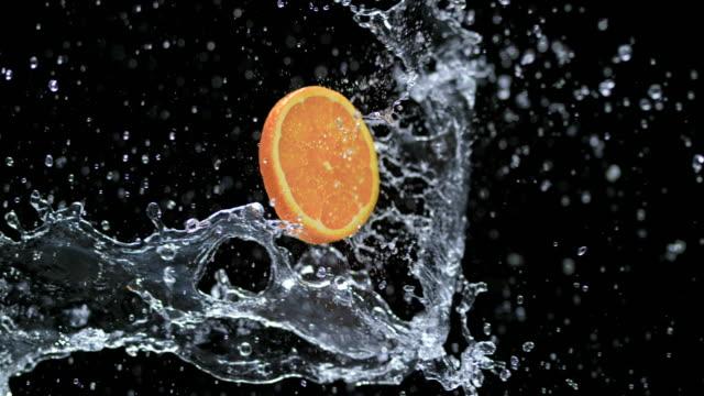 SLO MO Slice of orange in a water splash video