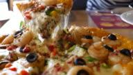 Slice of shrimp pizza ,Dolly shot video