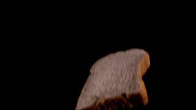 Slice Whole wheat Bread Drop on Slow Motion video