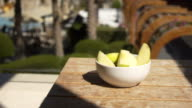 Sliced apples on pool background video