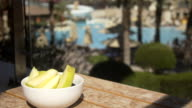 Sliced apples on pool background video