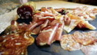 Slices dry-cured ham and salami video