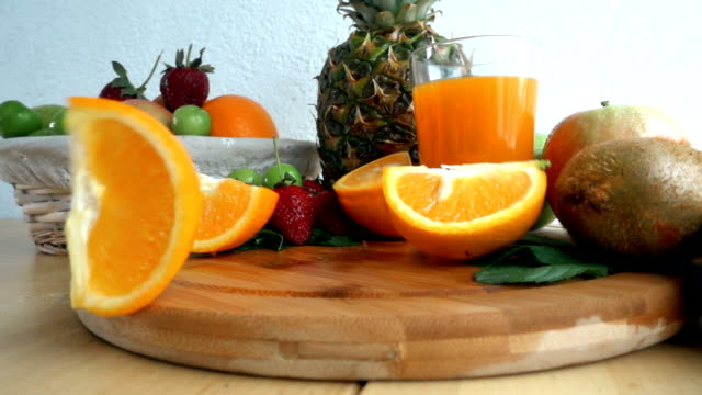 Slices Of Orange Drops Onto Cutting Board video
