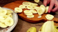 Slicing a banana into thin slices video