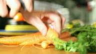 Slicing carrots in the kitchen video