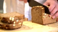 Slicing fresh rye bread with a knife. video