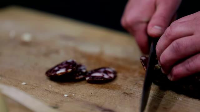 HD: Slicing salami into thin pieces video