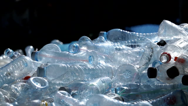 Slide Shot Piles of plastic bottles in recycling center video