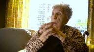 Sliding 4K Clip of an Elderly Woman in a Wheelchair video