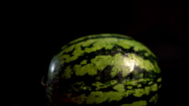 Sliding between fresh watermelons video
