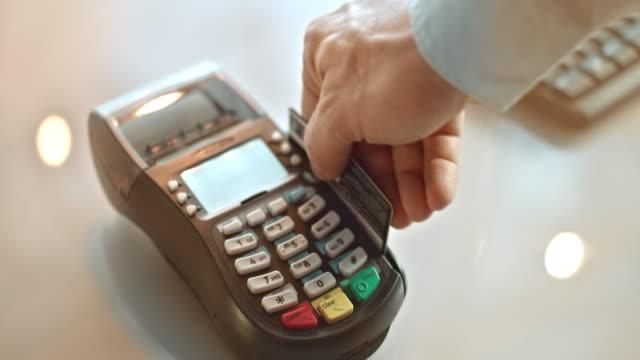 SLO MO sliding card through POS terminal and entering amount video