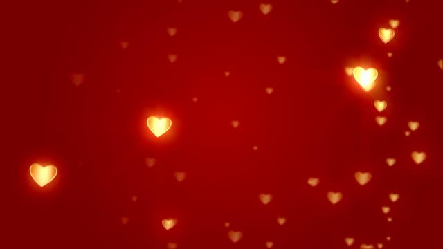 sliding valentine heart shapes animation on red background video