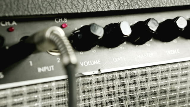 Sliding view on amplifier knobs and plugs video