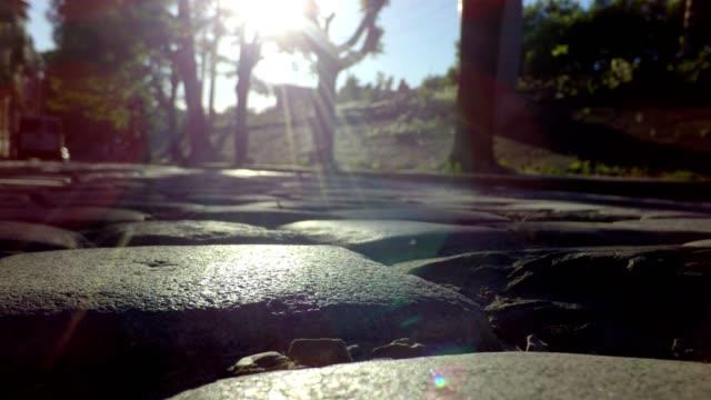 Slipping along Cobbled road towardas the sun video