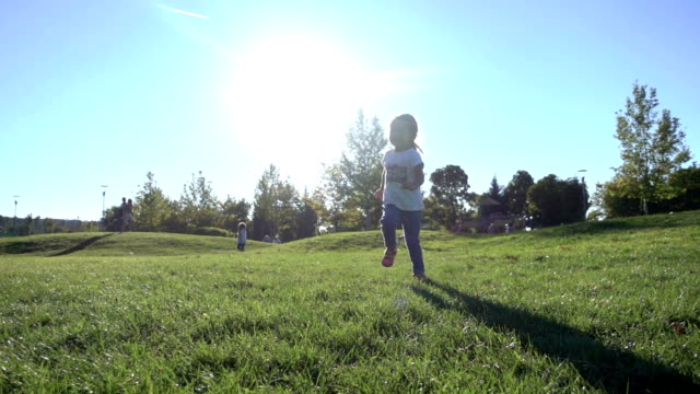 Slo Mo Little girl running in the park video