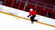 HD Slo-Mo Shot of Ice Hockey Player Skating with Puck video