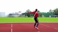 HD: Slo-Mo Shot of Young Woman Throwing Javelin video