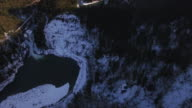 Slow Floating Aerial of Snowy Mountain Forest Valley with River Waterfall on Sunny Day video