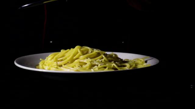Slow mo chef rubs cheese on spaghetti pasta video