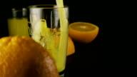 Slow mo. Fresh orange juice pour into a glass video