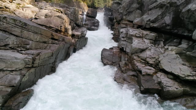 Slow Motion 4K Drone Shot of Rocky Canyon River Rapids Splashing with Strong Current video