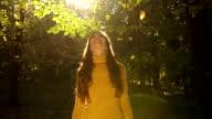 Slow Motion Autumn Leaves Woman Raising Hands video