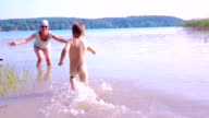 Slow motion: Baby and grandmother in the water video