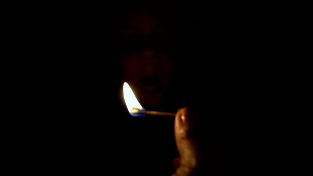 Slow motion: baby boy blowing out fire flame video