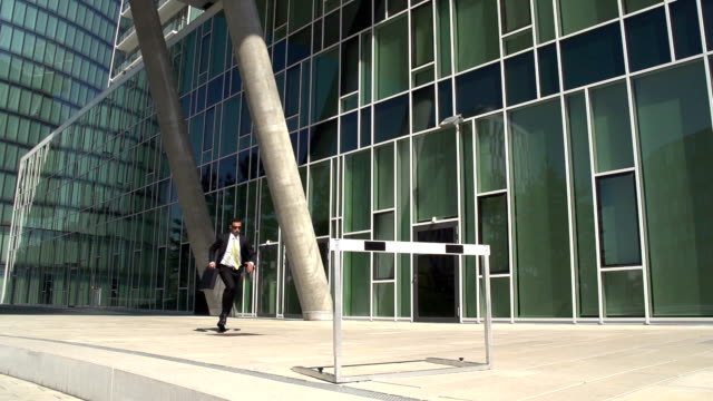 slow motion business hurdler office block video
