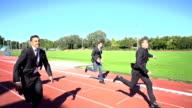 slow motion business men finishing run video