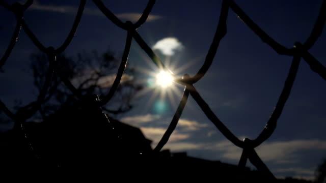 Slow motion: Chain Fence Against Golden Sun video