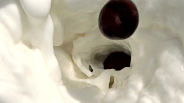 slow motion Chocolate Balls Splashing Into Milk video